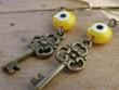 Veselé kovové náušnice - Klíček